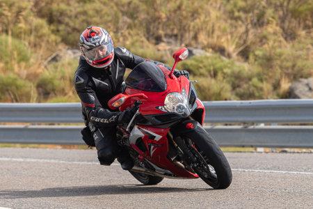 biker circulating on asphalt; photograph captured during the month of September 2020 in the province of Avila, Spain. Редакционное