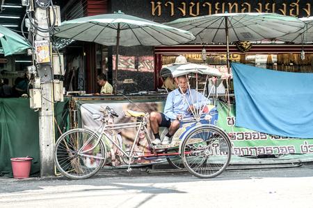 trishaw: Thailad three wheels with old man Editorial