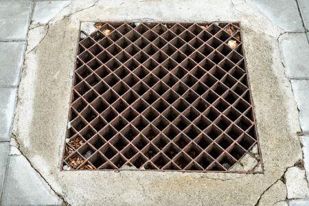 drain: Rusty metal drain cover
