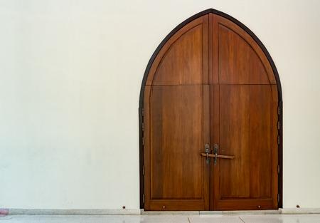 Wooden church door with wood lock Reklamní fotografie