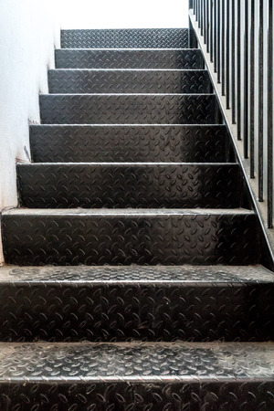 railing: Black metal staircase with metal railing