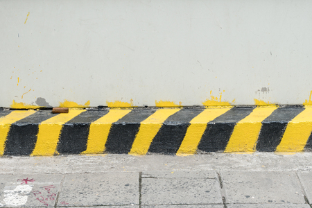 yellow line: Black and yellow traffic sign on road border