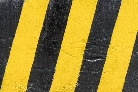 highway sign: Black and yellow traffic sign on concrete wall