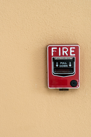 sprinkler alarm: Red fire switch on concrete wall