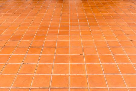 Old brown ceramic tile floor perspective view Reklamní fotografie