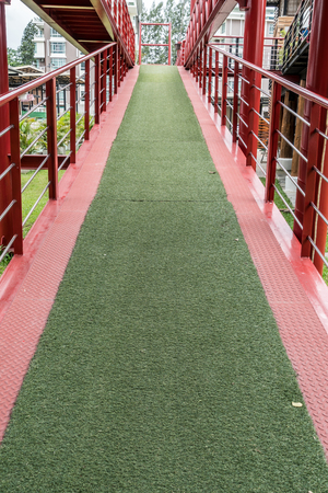 on ramp: Metal ramp for wheelchair with artificial grass Stock Photo