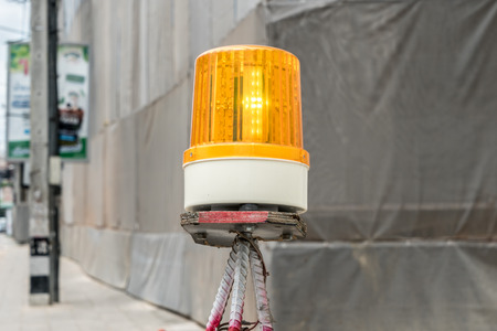 Yellow siren light on construction site