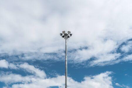 spot light: Spot light pole on white cloud and blue sky