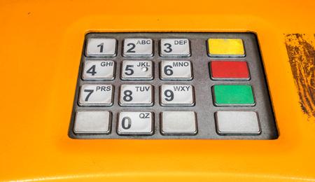 teclado numérico: White numeric keypad on the automatic money exchange machine Foto de archivo
