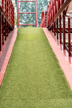 disablement: Metal ramp with artificial green grass for wheelchair