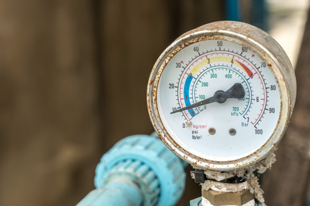 gage: Water pressure gage on blurred pipe background