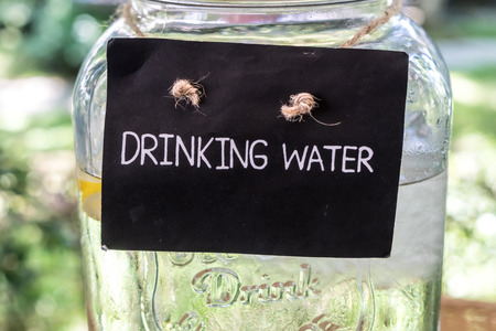 drinking water sign: Drinking water sign on glass jar