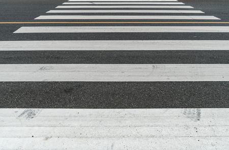 crosswalk: White crosswalk on asphalt road