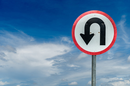 u turn sign: U turn sign on white cloud and blue sky background with clipping path