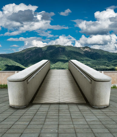 Concrete ramp to mountain with blue sky, concept idea for freedom or travel