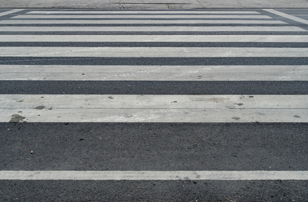 paso de peatones: White crosswalk on asphalt road