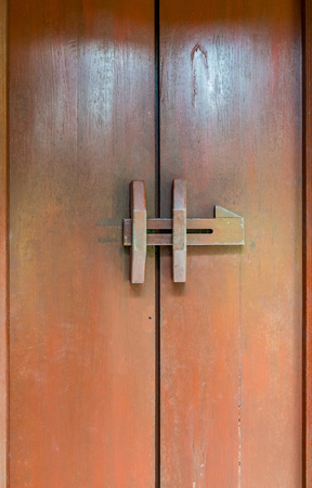 hasp: Old wooden door with wood hasp locked