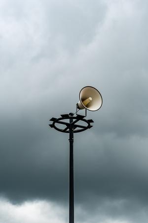 White horn speaker on dark cloud background Stock Photo