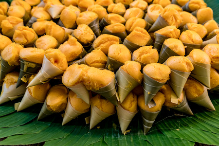 coconut palm sugar: Thais dessert made from sugar palm tree in coconut leaf cone