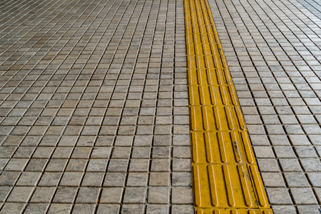 tactile: Tactile paving for blind handicap on tiles pathway