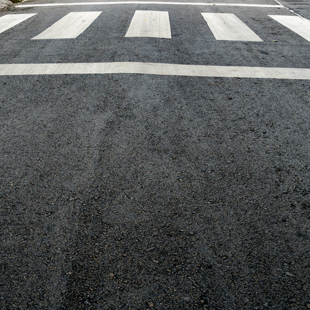paso peatonal: Perspective of White crosswalk on asphalt road