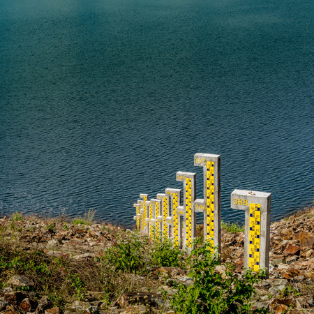 depth measurement: Water level pole at the lake
