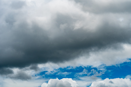 Dark cloud of thunder storm on blue sky background Stock Photo