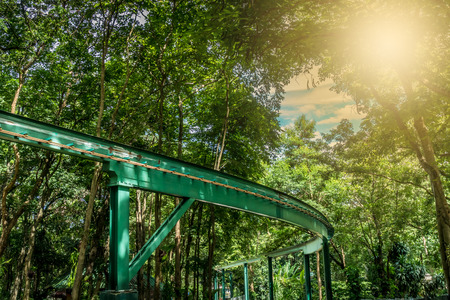 Green Track of monorail in the park Stock Photo