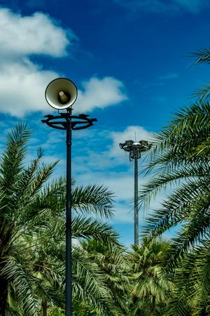 White horn speaker on white cloud background in the park