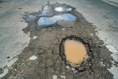 Pothole on the asphalt road