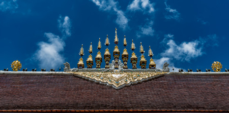 Part of Thai temple roof with blue sky background