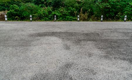 Black and white concrete traffic pole on asphalt gravel country road Stockfoto
