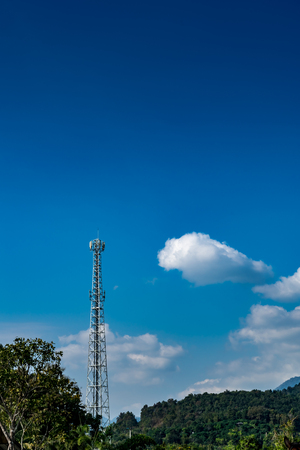 Communications tower pylon on blue sky background
