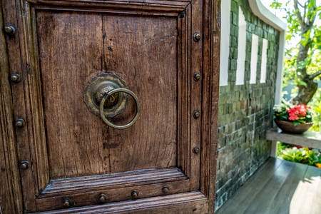 Brown wooden doors with old style iron handle