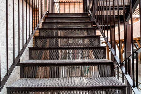 Black diamond pattern metal staircase with railing