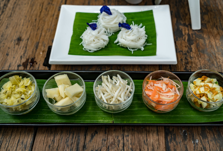 glass of vegetable with Rice vermicelli on white plate