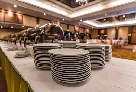 Stack of white ceramic dish ready for party Reklamní fotografie