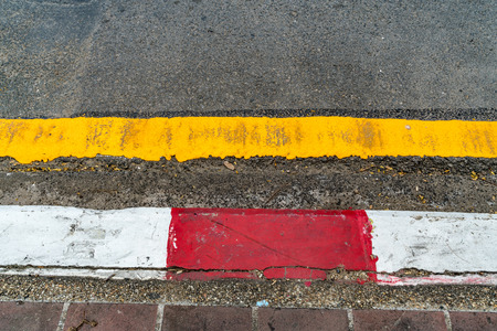 Asphalt road and Concrete sidewalk with Red and white concrete curb