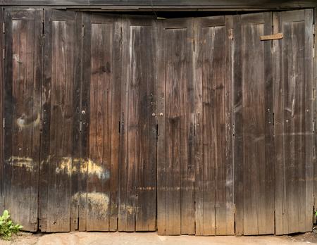Old brown weatherd wooden door