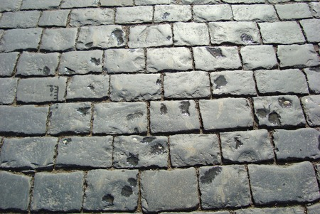 rough road: Gray texture of rough jagged stones on the road. Ancient road texture. Medieval path background. Web background. Stock Photo