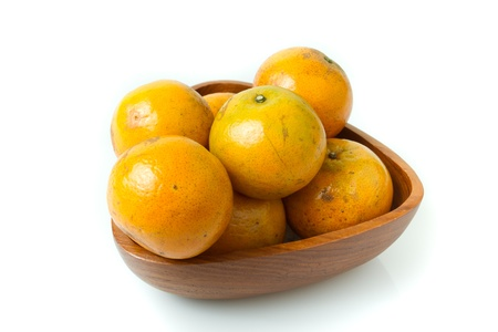 Orange in the wood bowl Stock Photo - 15364459