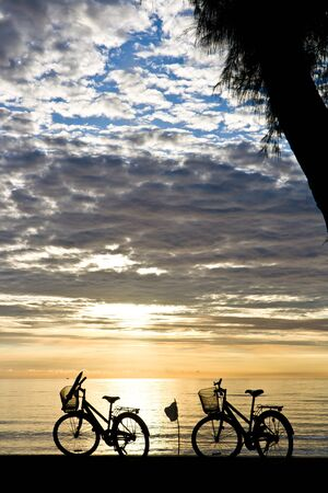 Silhouette bicycles in the morning beach photo