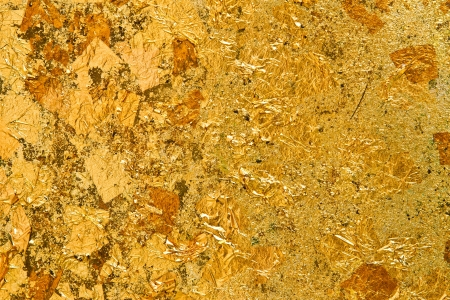 gold leaf: Gold leaf on the wall backgroung Stock Photo