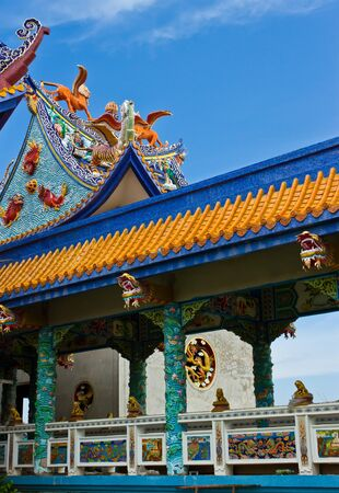 Two dragons on the Chinese temple roof Stock Photo