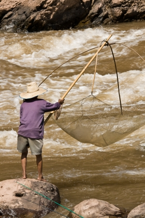 swiftly: Fishing in the rapid river Stock Photo