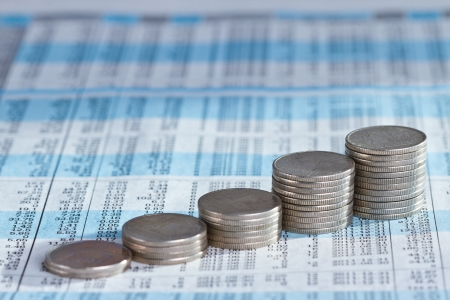 Rising stack of coin graph on investment report Stock Photo