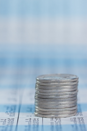 Rising coin on investment report Stock Photo