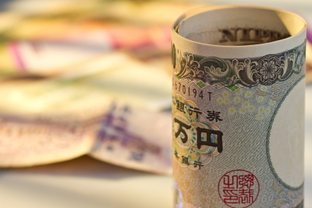 Japan Yen in front of multi national bank note Stock Photo