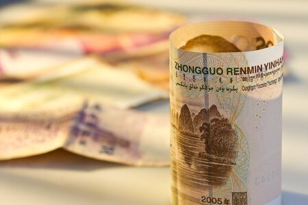 China Yuan in front of multi national bank note Stock Photo