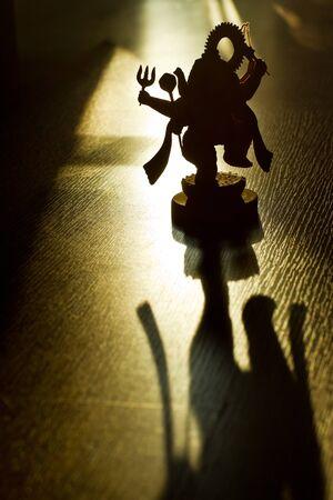 divinity: Silhouette Ganesh on golden light